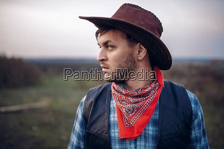 portrait of cowboy in leather jacket