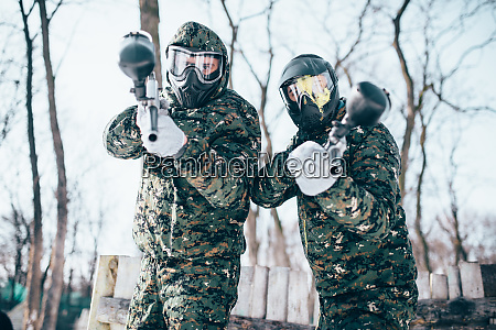 paintball players in splattered masks after