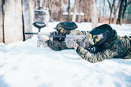 two paintball players lies on the