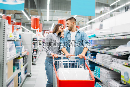 couple with cart in a supermarket