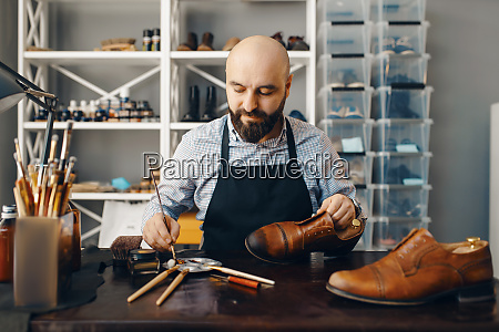 bootmaker with brush tints shoes footwear