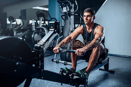 athlete, training, press, on, exercise, machine - 28062555
