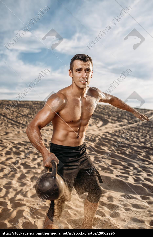 athlete, with, kettlebell, in, desert, , flying - 28062296