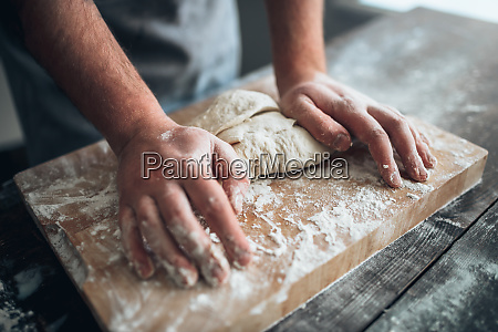 baker, hands, kneading, the, dough, with - 28062853