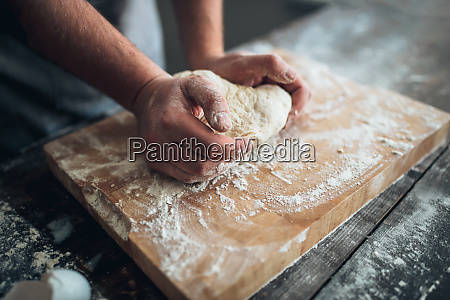 baker, hands, kneading, the, dough, with - 28062858
