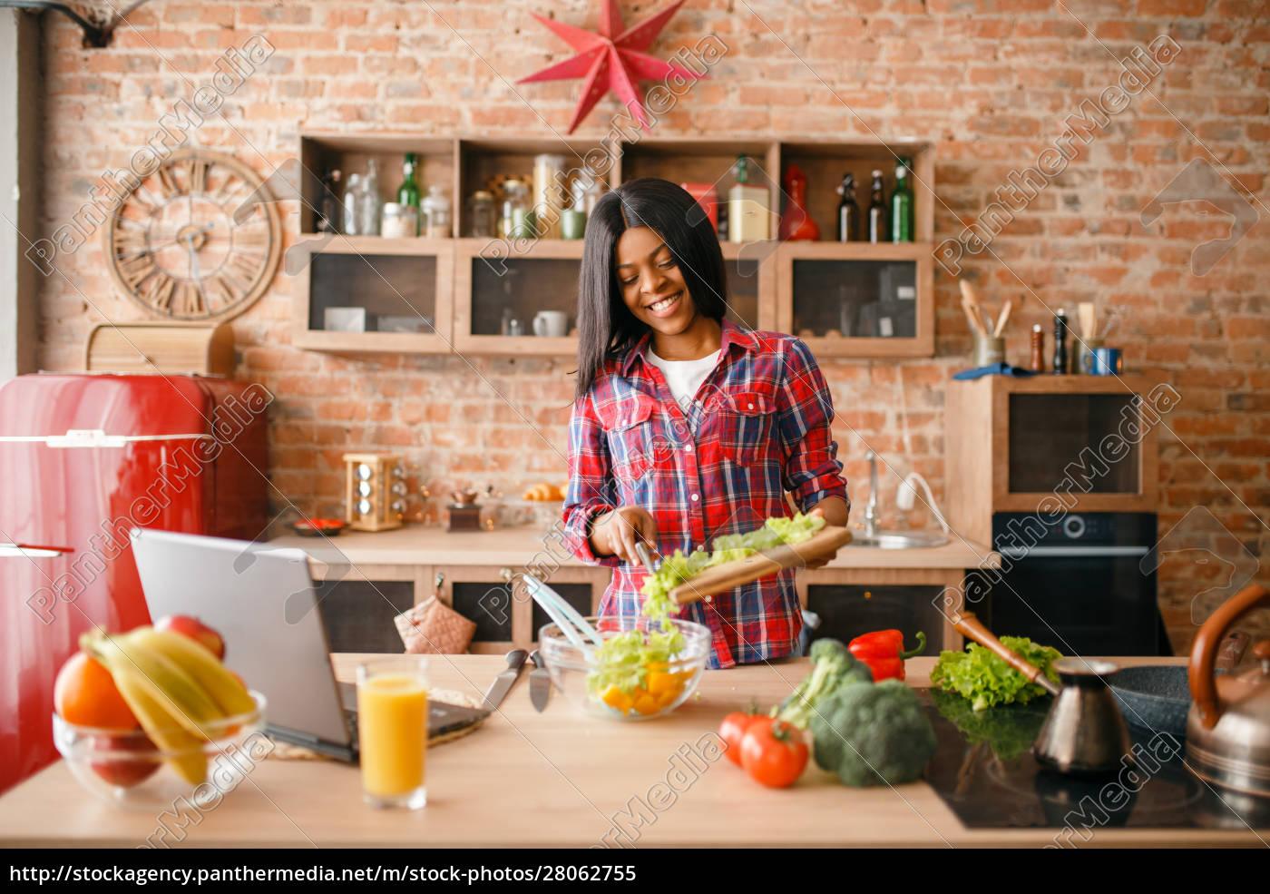black, woman, looking, recipe, on, laptop - 28062755