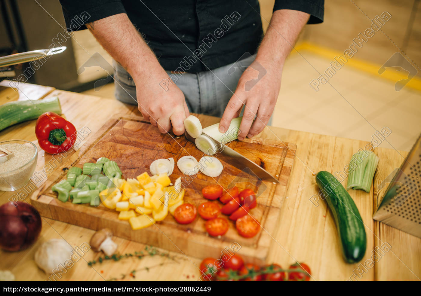 chef, with, knife, cuts, mushrooms, on - 28062449