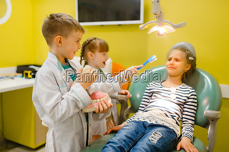 children, in, uniform, playing, dentist, , playroom - 28062076