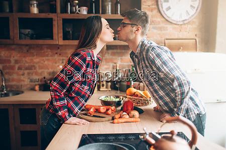 couple, kissing, while, preparing, a, romantic - 28062164