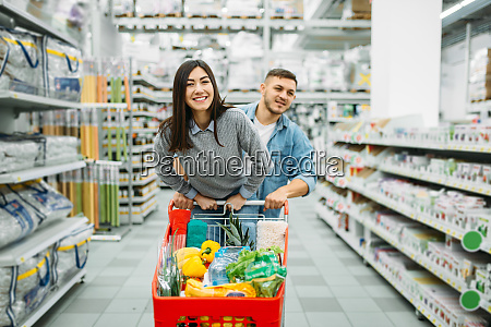 couple, with, cart, full, of, goods - 28062799