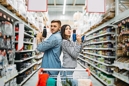 couple, with, electric, screwdrivers, , power, tools - 28062912