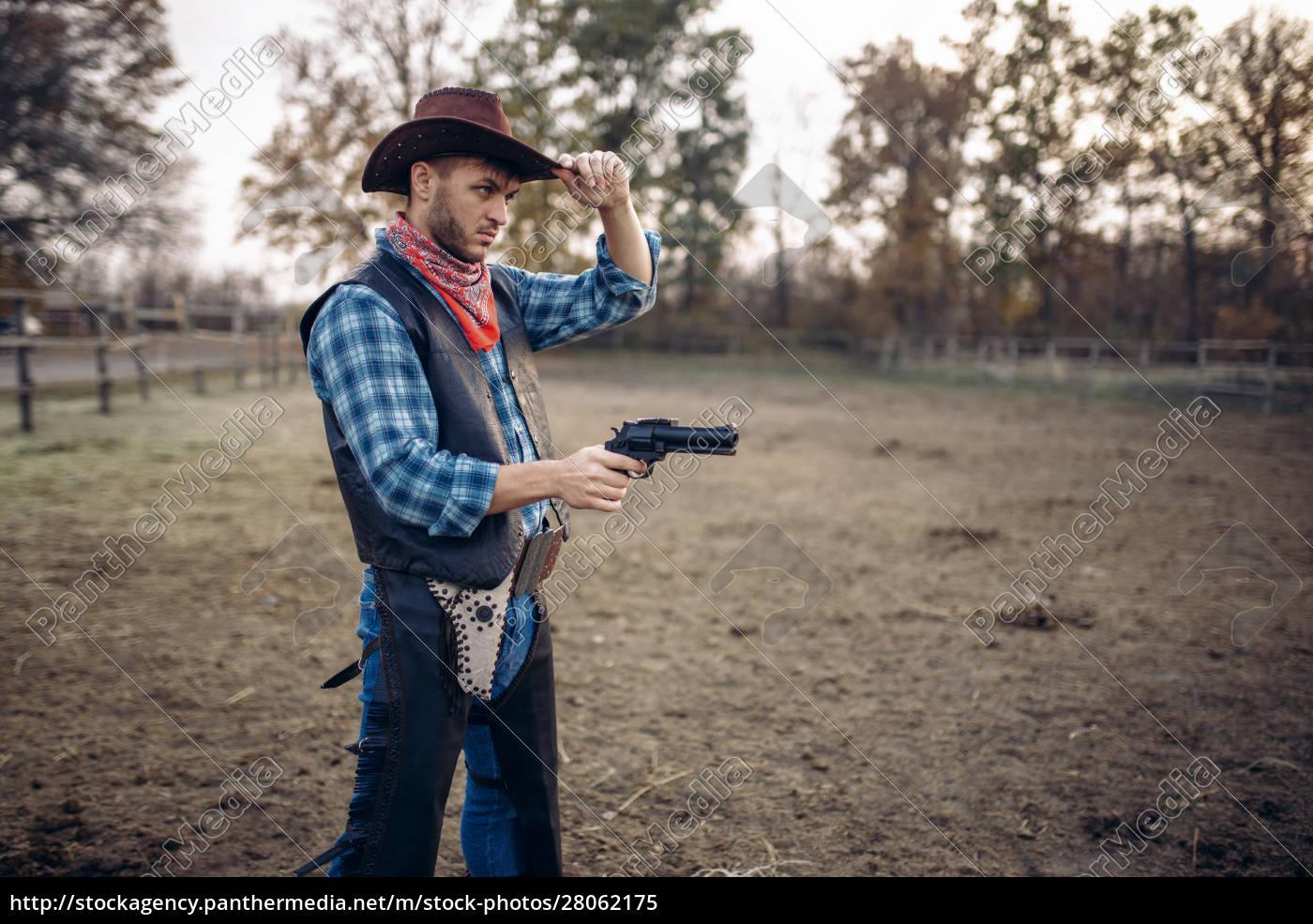 cowboy, with, revolver, , gunfight, on, ranch, - 28062175