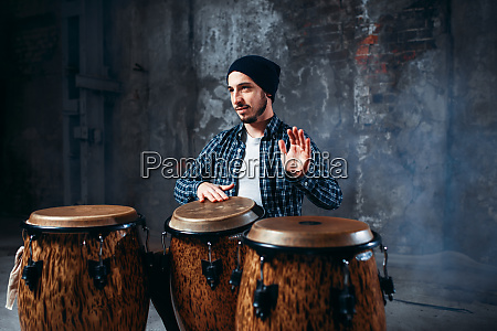 drummer, playing, on, wooden, bongo, drums, - 28062522