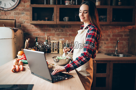female, cook, in, apron, looks, at - 28062267