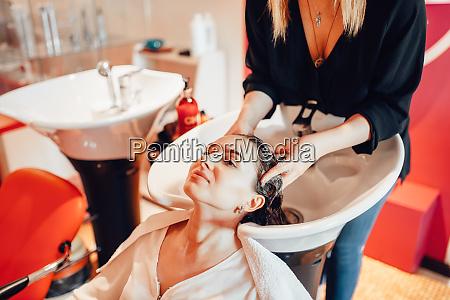 female, hairdresser, washes, customer, hair, in - 28062013