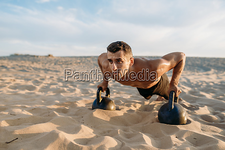 male, athlete, doing, push-up, exercises, in - 28062598