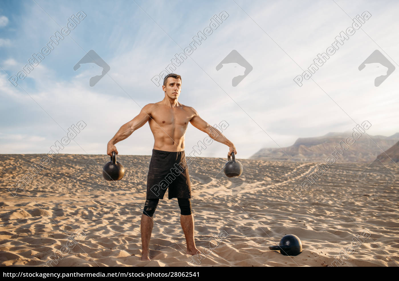 male, athlete, with, two, kettlebells, in - 28062541