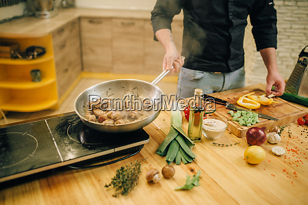 male, chef, cooking, meat, with, vetables - 28062413