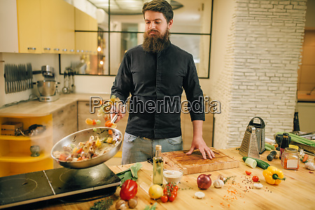 male, chef, cooking, meat, with, vetables - 28062532