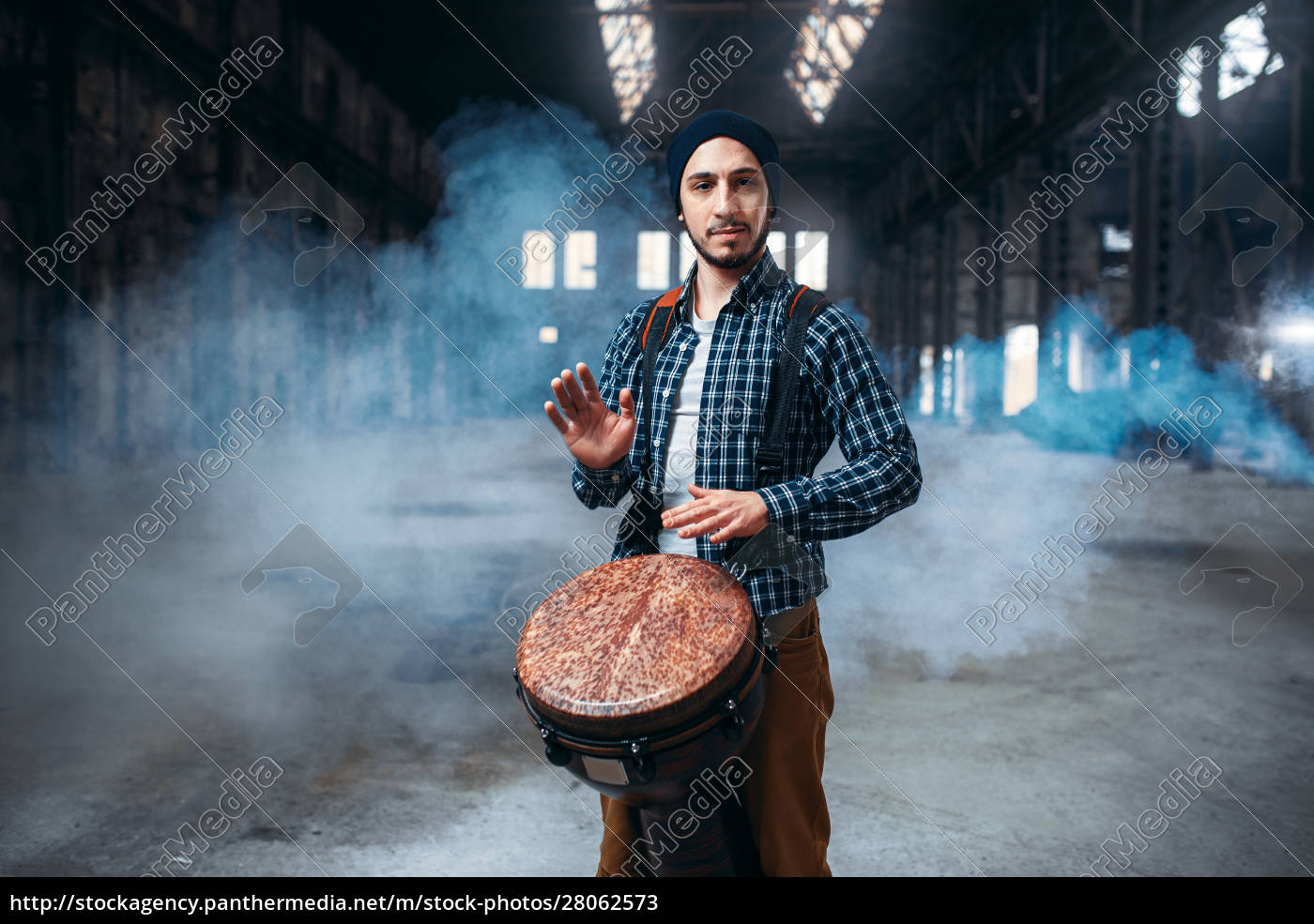 male, drummer, playing, on, wooden, drum - 28062573