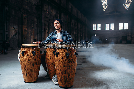 male, drummer, plays, on, wooden, drums - 28062410