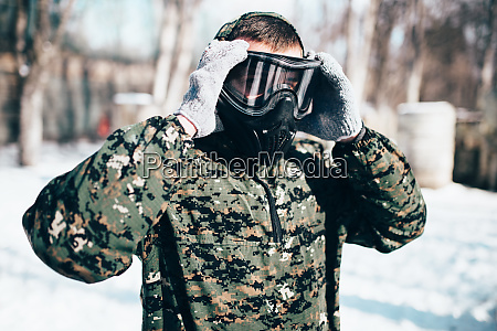 male, paintball, player, puts, on, protection - 28062457