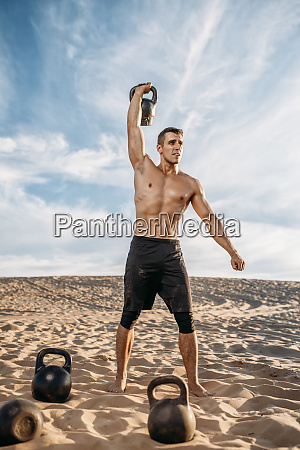 muscular, male, athlete, with, kettlebell, in - 28062388