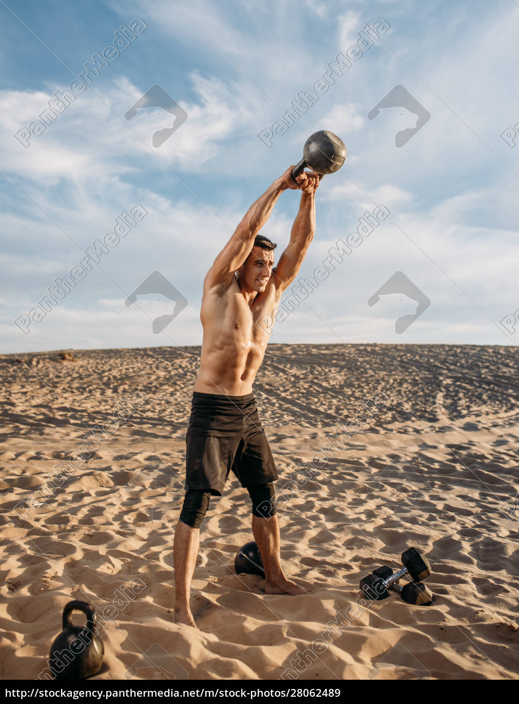 muscular, male, athlete, with, kettlebell, in - 28062489