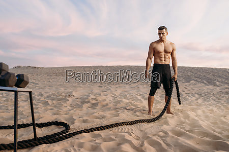 muscular, man, doing, exercise, with, rope - 28062903