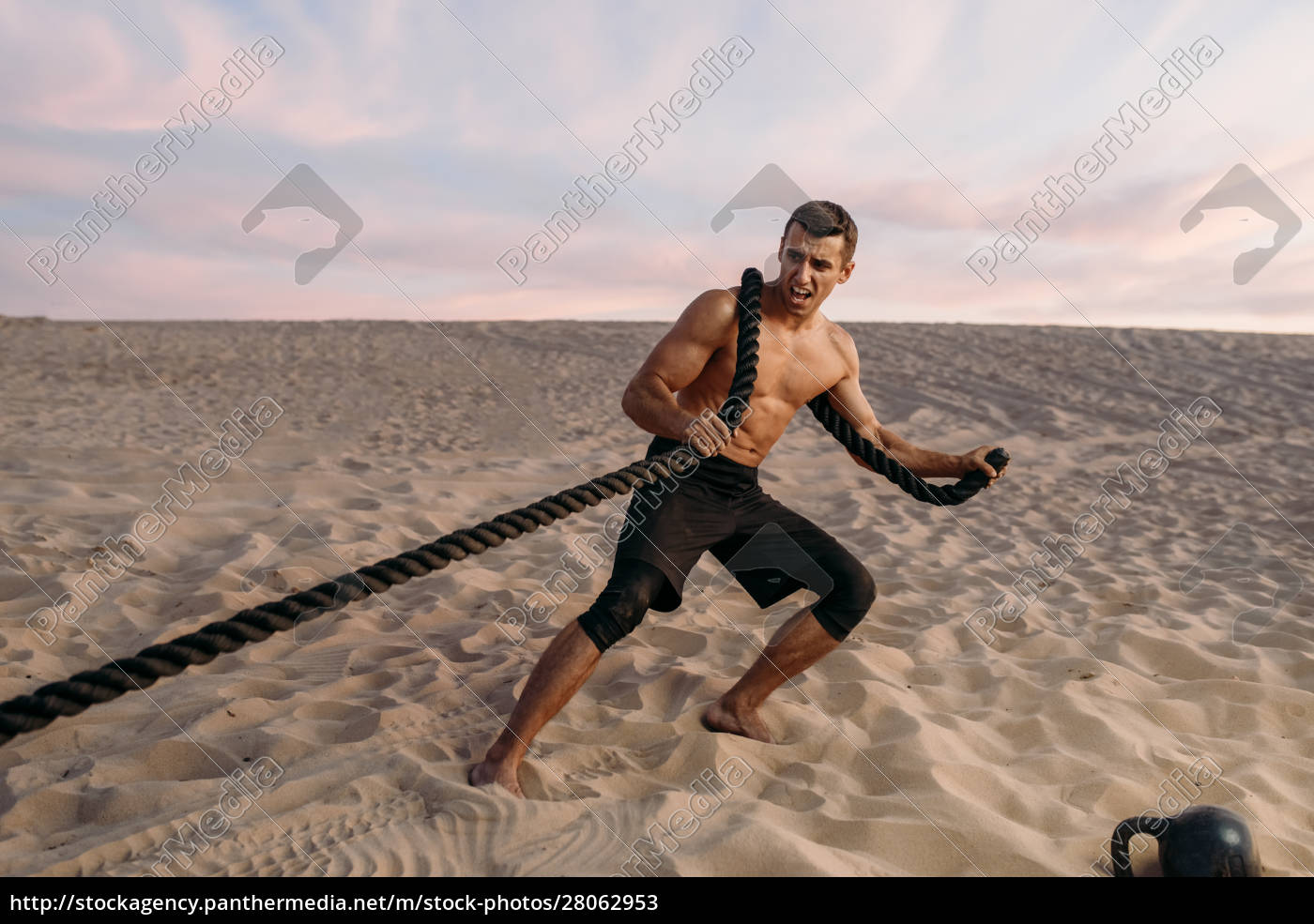 muscular, man, doing, exercise, with, rope - 28062953