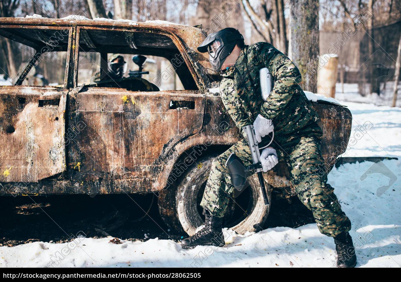 paintball, battle, , burned, car, in, winter - 28062505