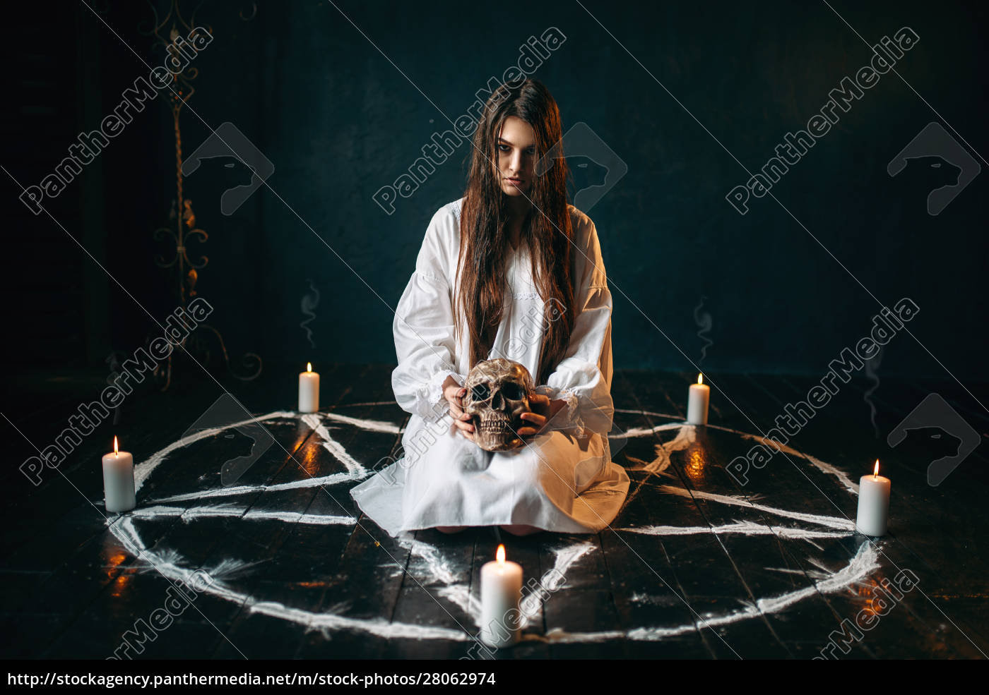 woman, holds, human, skull, in, hand, - 28062974