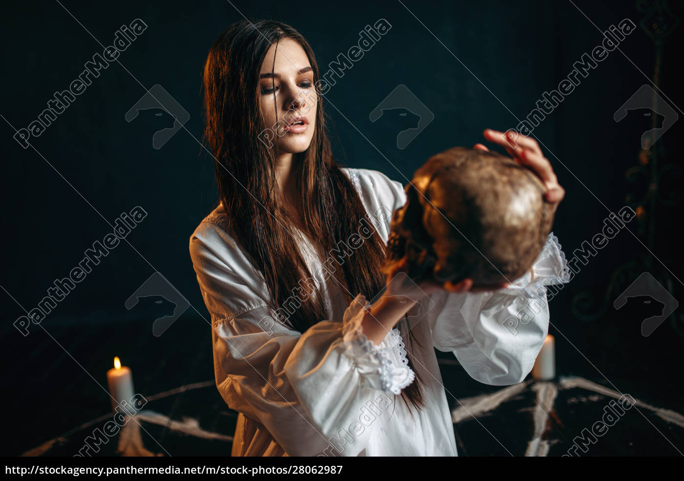 woman, holds, human, skull, in, hand, - 28062987