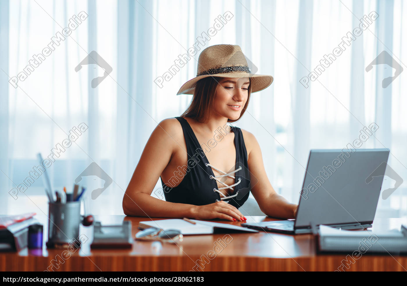 woman, works, on, laptop, , and, dreaming - 28062183