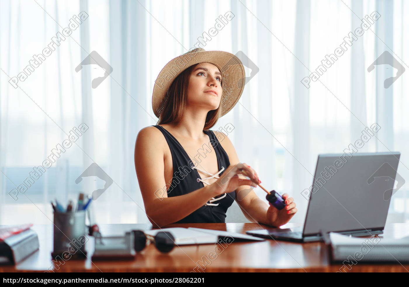 woman, works, on, laptop, , and, dreaming - 28062201
