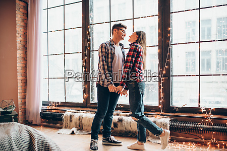 young, couple, hugs, against, large, window - 28062372
