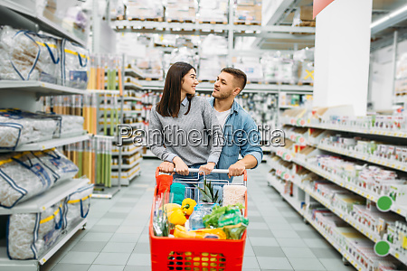 young, woman, with, cart, full, of - 28062810
