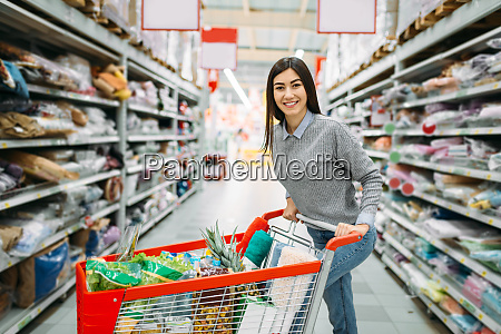 young, woman, with, cart, full, of - 28062832