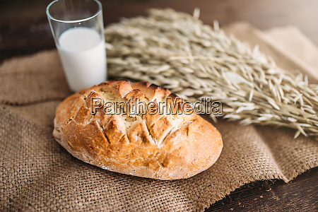 bread wheat and glass of milk