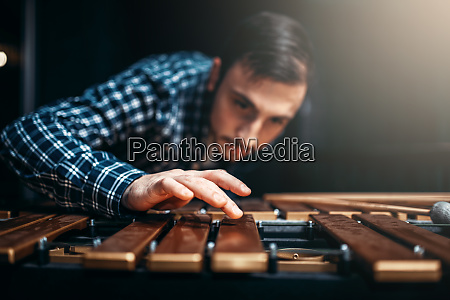 xylophone player with sticks musician in