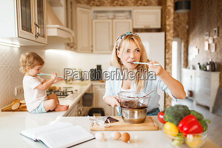 mother and her daughter tastes melted