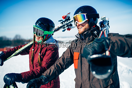 male and female skiers poses with