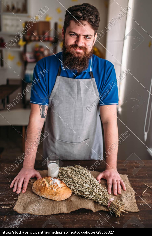 baker, against, bread, , wheat, , milk, on - 28063327
