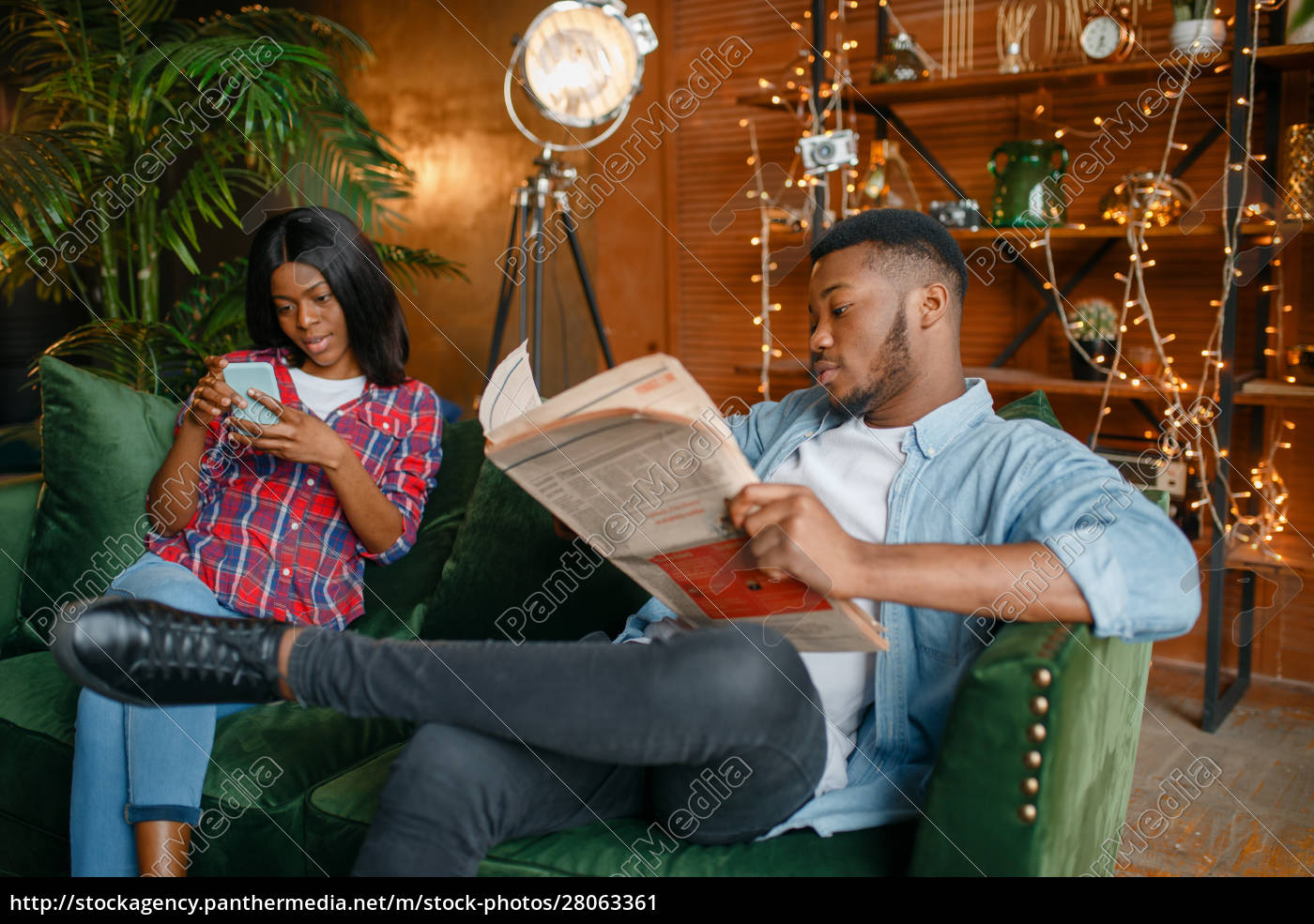 black, man, reading, newspaper, , his, woman - 28063361