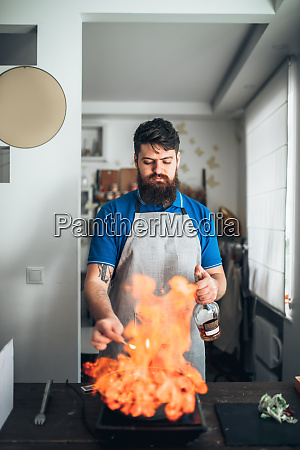chef, against, frying, pan, with, fire, - 28063222
