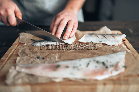 chef, cuts, raw, fish, slices, on - 28063103