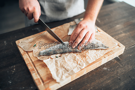 chef, cuts, raw, fish, slices, on - 28063132