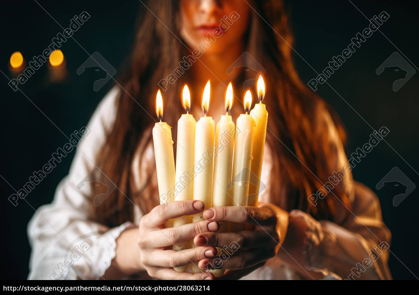 female, person, holds, candles, in, hands, - 28063214
