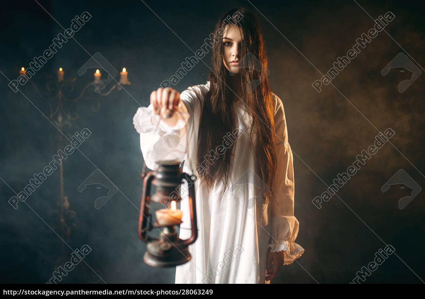female, person, holds, kerosene, lamp, , dark - 28063249