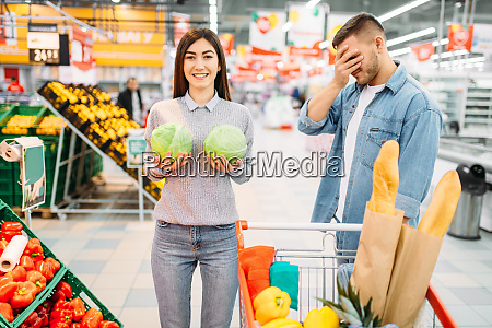 woman, leaned, the, heads, of, cabbage - 28063245